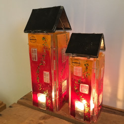 Glashuse med fyrfadslys