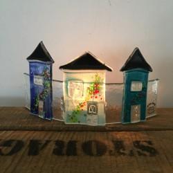 glashuse med fyrfadslys blå